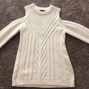 White knit sweater with shoulder cut outs